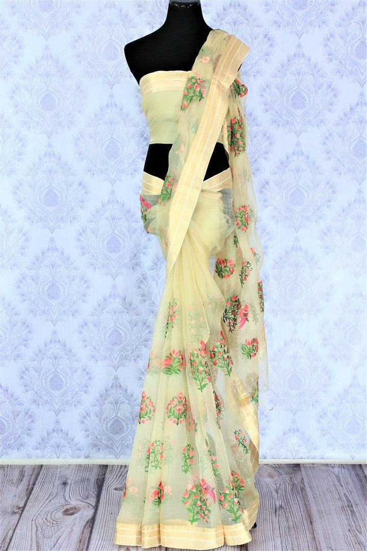 Escape in ecstasy in this summer bloom cream floral work organza saree with stunning beige border. Style this sophisticated sari with a matching blouse and strut the town like a diva. Shop designer chiffon sarees, linen sari, silk saree online or visit Pure Elegance store, USA.-full view