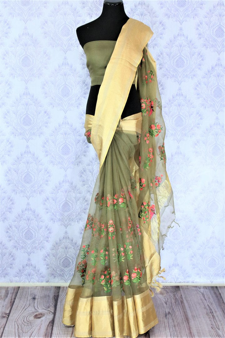 Dreaming hues blend in this green floral work organza saree. The statement-worthy gold zari border on the nine yards along with the same coloured blouse. Style this sari to parties, special events, or formal events. Shop designer silk sari, chiffon saree, embroidered sari online or visit Pure Elegance store, USA. -full view