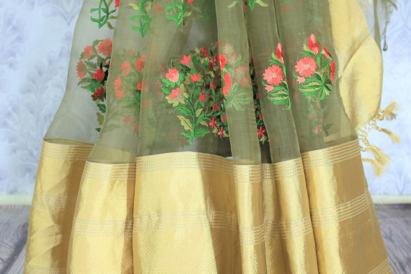 Dreaming hues blend in this green floral work organza saree. The statement-worthy gold zari border on the nine yards along with the same coloured blouse. Style this sari to parties, special events, or formal events. Shop designer silk sari, chiffon saree, embroidered sari online or visit Pure Elegance store, USA. -pleats