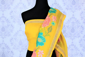 Gorge on this bright yellow floral work organza saree. It comes with a nuanced embroidered border and a bright yellow blouse with embroidered piping. The floral embroidery features vibrant colors to enhance the beauty. Shop such designer sarees, linen sari, georgette saree online or visit Pure Elegance store, USA. -blouse pallu