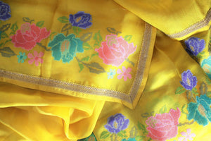 Gorge on this bright yellow floral work organza saree. It comes with a nuanced embroidered border and a bright yellow blouse with embroidered piping. The floral embroidery features vibrant colors to enhance the beauty. Shop such designer sarees, linen sari, georgette saree online or visit Pure Elegance store, USA. -details