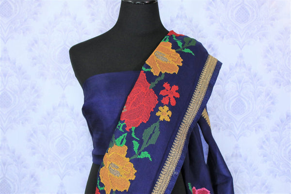 Feel the blues in this royal blue floral work organza saree. It comes with an elaborate embroidered border and is a perfect pick for parties. Style this statement sari with a plain blue blouse to fetch compliments galore. Shop handcrafted silk saris, chiffon saree, cotton saree online or visit Pure Elegance store, USA.-blouse pallu