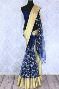 Step up your style game in this beautiful royal blue floral work organza saree. A perfect ensemble for parties, social events, family gatherings, style it with a plain blue blouse. Let the rich gold zari detailing on border enhance the overall look. Shop such designer saris online or visit Pure Elegance store, USA. -full view