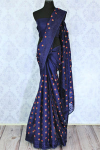 Add a touch of elegance with our exquisitely tailored royal blue organza silk saree. It comes with a floral embroidery all over and a beautiful lace border. Style it with a gorgeous plain blue blouse. Shop designer silk sari, embroidered saree, kalamkari sari  online or visit Pure Elegance store, USA.-full view