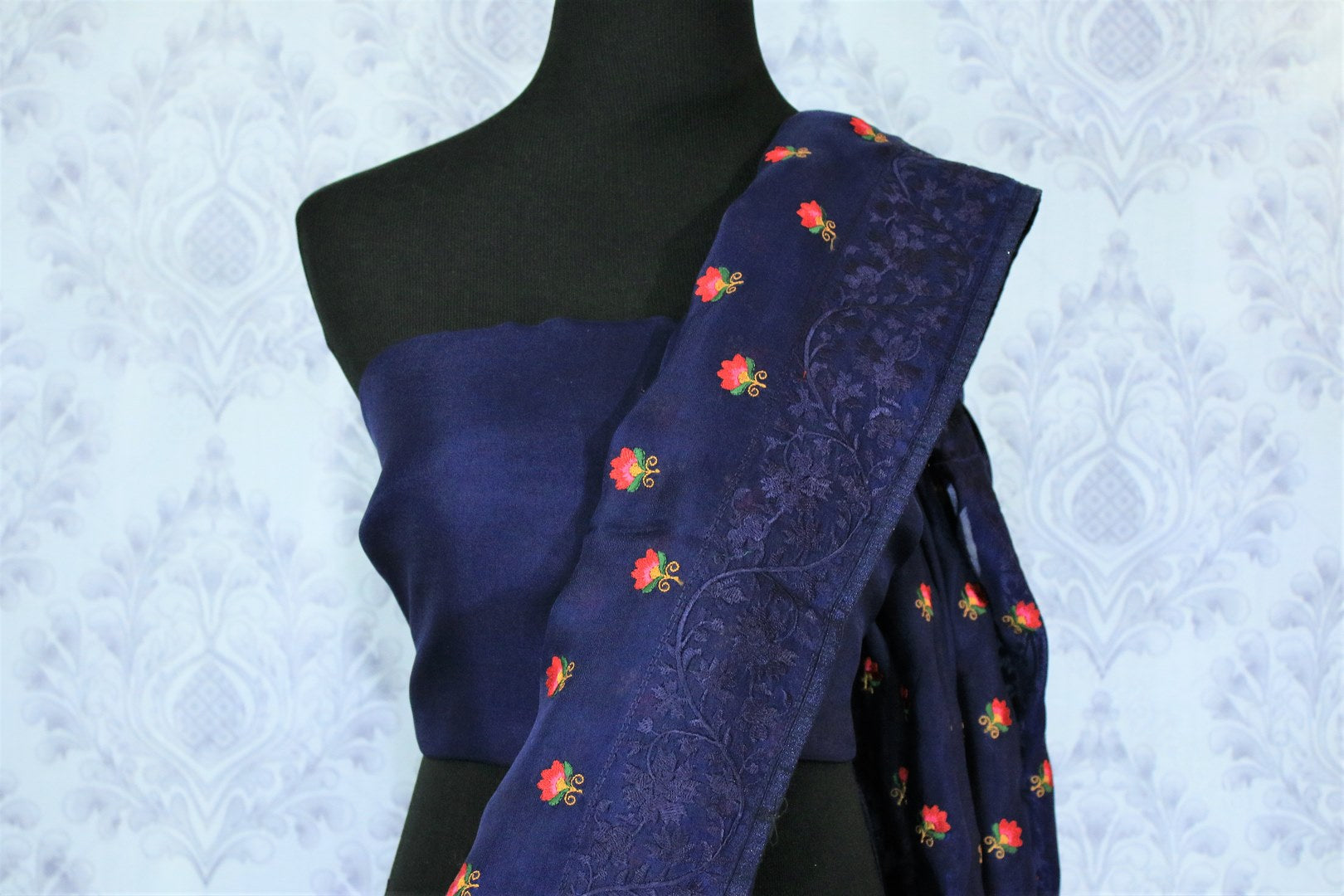 Add a touch of elegance with our exquisitely tailored royal blue organza silk saree. It comes with a floral embroidery all over and a beautiful lace border. Style it with a gorgeous plain blue blouse. Shop designer silk sari, embroidered saree, kalamkari sari  online or visit Pure Elegance store, USA.-blouse pallu