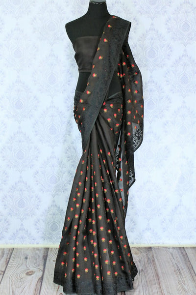 Gorge on the beauty of this black organza silk saree. It comes with a bright floral work design all over graced with a lace border to enhance the visual appeal. Style this sari with a plain black blouse. Shop designer saris, silk saree, printed saree, kalamkari saree online or visit Pure Elegance store, USA.-full view