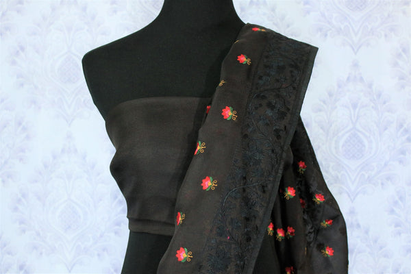 Gorge on the beauty of this black organza silk saree. It comes with a bright floral work design all over graced with a lace border to enhance the visual appeal. Style this sari with a plain black blouse. Shop designer saris, silk saree, printed saree, kalamkari saree online or visit Pure Elegance store, USA.-blouse pallu