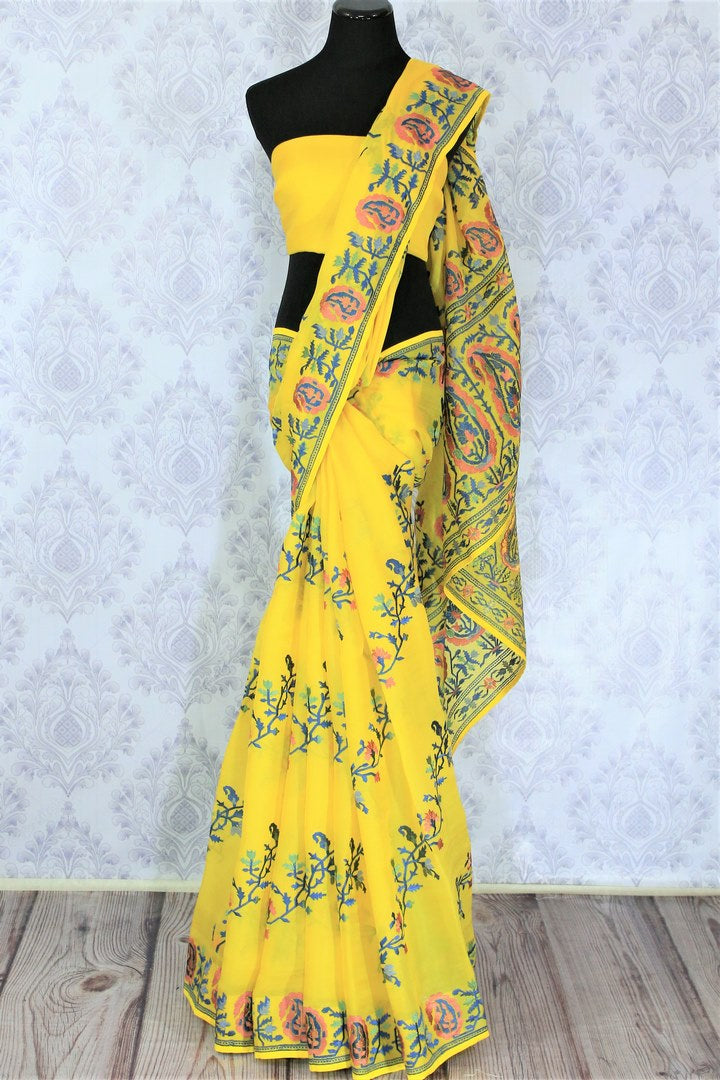 Invest in this summer staple bright yellow-hued organza silk saree. It features gorgeous floral embroidery all over and is paired with a matching yellow blouse. Shop handcrafted silk saree, printed sari, embroidered saree online or visit Pure Elegance store, USA.-full view
