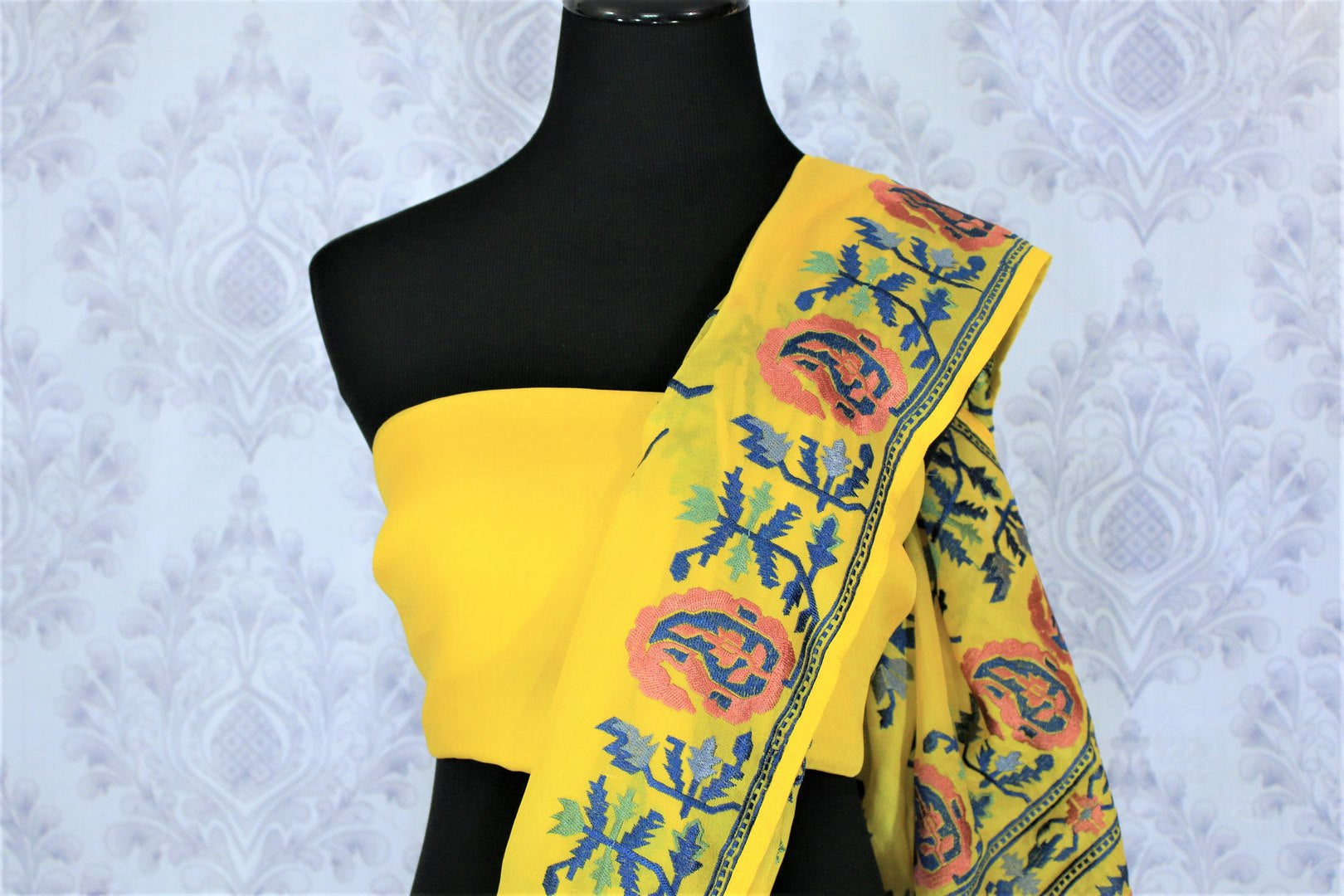 Invest in this summer staple bright yellow-hued organza silk saree. It features gorgeous floral embroidery all over and is paired with a matching yellow blouse. Shop handcrafted silk saree, printed sari, embroidered saree online or visit Pure Elegance store, USA.-blouse pallu