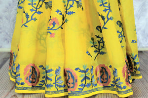 Invest in this summer staple bright yellow-hued organza silk saree. It features gorgeous floral embroidery all over and is paired with a matching yellow blouse. Shop handcrafted silk saree, printed sari, embroidered saree online or visit Pure Elegance store, USA.-pleats