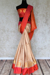 Crafted with sensibility, this cream kanjivaram silk designer sari is worth investing. The minimal yet statement-worthy buta work detailing on the border and blouse looks mesmerizing. Style this saree to festivities and events. Shop handloom saris, ikkat sarees, printed sari online or visit Pure Elegance store, USA. -full view