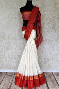 The classic white and red tussar silk designer sari is every woman's dream come true. Enhance your beauty in this silk saree with embroidered border and contrasting red blouse and strut to festivities. Shop designer silk sarees, kanjivaram silk saris, printed sarees online or visit Pure Elegance store, USA. -full view