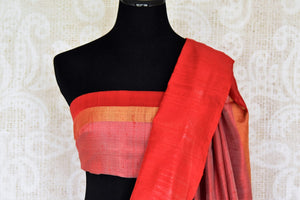 The classic white and red tussar silk designer sari is every woman's dream come true. Enhance your beauty in this silk saree with embroidered border and contrasting red blouse and strut to festivities. Shop designer silk sarees, kanjivaram silk saris, printed sarees online or visit Pure Elegance store, USA. -blouse pallu