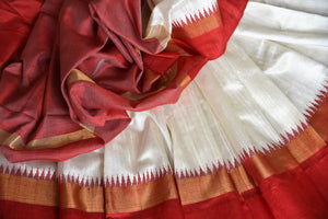 The classic white and red tussar silk designer sari is every woman's dream come true. Enhance your beauty in this silk saree with embroidered border and contrasting red blouse and strut to festivities. Shop designer silk sarees, kanjivaram silk saris, printed sarees online or visit Pure Elegance store, USA. -details