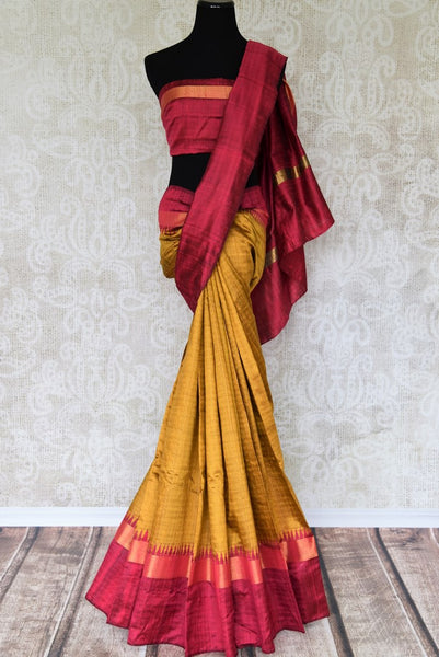 Enriching hues of gold and red blended seamlessly in this designer tussar silk sari. Doll up in this classic saree with striking gold embroidery on the pallu and border. It comes with a contrasting red blouse detailed with zari. Shop handloom silk saree, printed sari, ikkat sari online or visit Pure Elegance store, USA. -full view