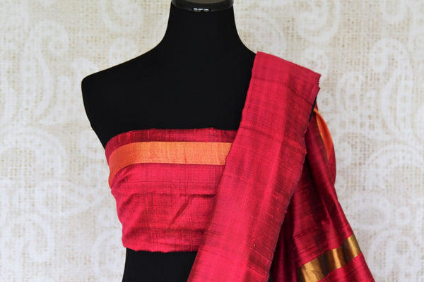 Enriching hues of gold and red blended seamlessly in this designer tussar silk sari. Doll up in this classic saree with striking gold embroidery on the pallu and border. It comes with a contrasting red blouse detailed with zari. Shop handloom silk saree, printed sari, ikkat sari online or visit Pure Elegance store, USA. -blouse pallu