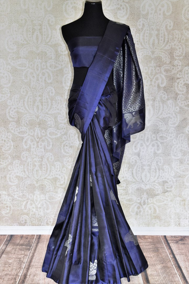 Elevate your authentic charm in this royal blue buta work kanjivaram silk saree. Graced with silver weave, this gorgeous sari comes with a heavily woven pallu and subtle blue blouse. Shop handcrafted silk sarees, printed sari, lehenga cholis, Indian dresses, ikkat sarees online or visit Pure Elegance store, USA.-full view