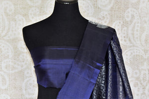 Elevate your authentic charm in this royal blue buta work kanjivaram silk saree. Graced with silver weave, this gorgeous sari comes with a heavily woven pallu and subtle blue blouse. Shop handcrafted silk sarees, printed sari, lehenga cholis, Indian dresses, ikkat sarees online or visit Pure Elegance store, USA.-blouse pallu