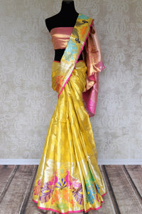 Grace the royal weddings in this exquisitely designed Yellow Kanjeevaram silk saree. It comes with handwoven peacock details on the border, a rich zari silk heavy pallu and a contrasting blouse. Shop beautiful designer saris, banarsi silk sarees online or visit Pure Elegance store in USA. -full view