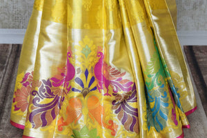 Grace the royal weddings in this exquisitely designed Yellow Kanjeevaram silk saree. It comes with handwoven peacock details on the border, a rich zari silk heavy pallu and a contrasting blouse. Shop beautiful designer saris, banarsi silk sarees online or visit Pure Elegance store in USA. -pleats
