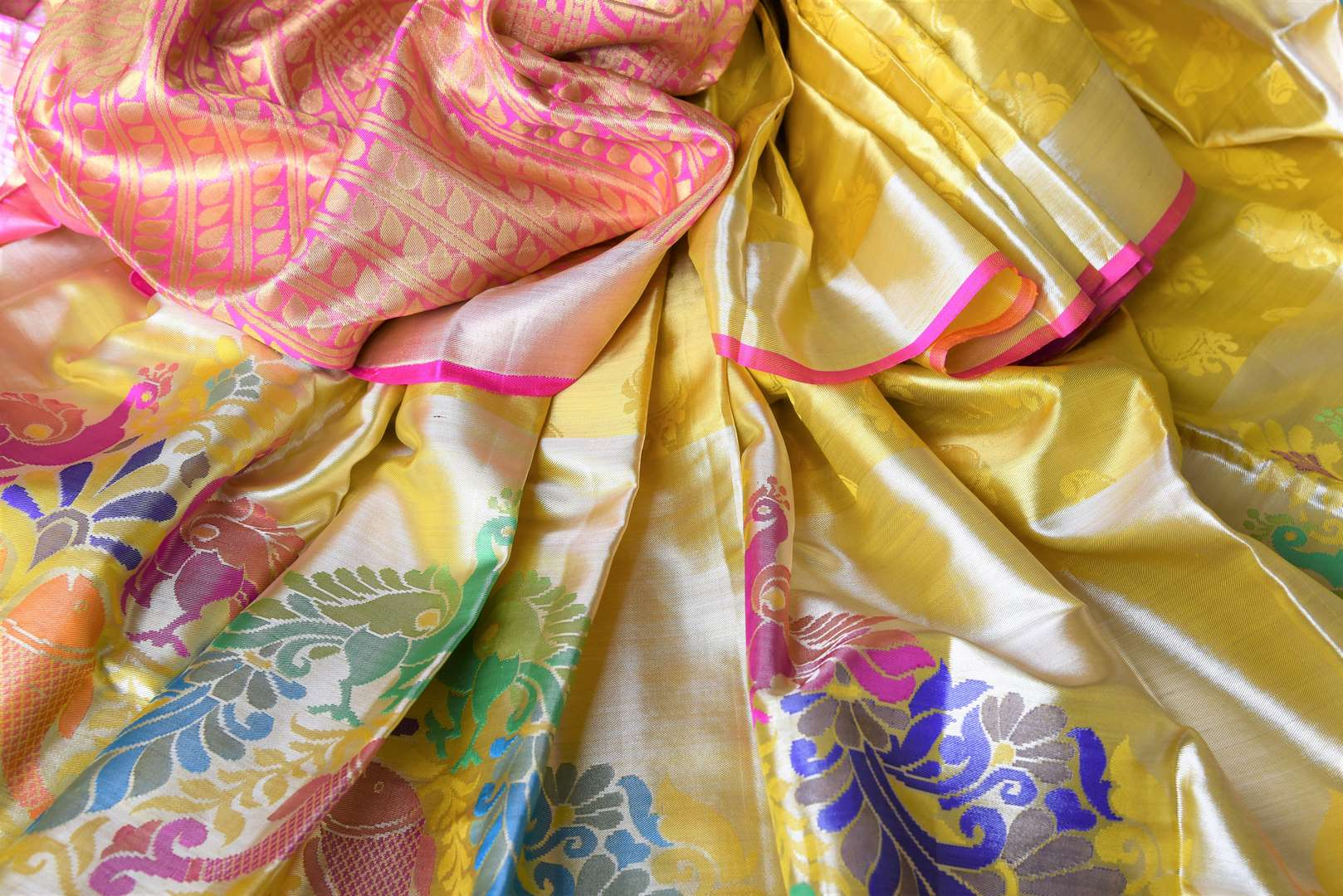 Grace the royal weddings in this exquisitely designed Yellow Kanjeevaram silk saree. It comes with handwoven peacock details on the border, a rich zari silk heavy pallu and a contrasting blouse. Shop beautiful designer saris, banarsi silk sarees online or visit Pure Elegance store in USA. -details