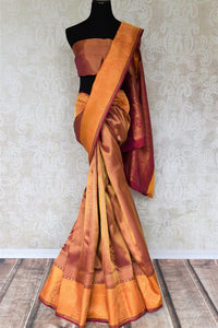 Emanate opulence in this flamboyant maroon with gold zari work Kanjeevaram silk saree at formal soirees. The rich zari pallu with a gorgeous contrasting blouse is a perfect go-to for wedding events. Shop beautifully handcrafted silk saris, banarsi sarees, handloom saris online or visit Pure Elegance store in USA. -full view