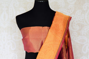 Emanate opulence in this flamboyant maroon with gold zari work Kanjeevaram silk saree at formal soirees. The rich zari pallu with a gorgeous contrasting blouse is a perfect go-to for wedding events. Shop beautifully handcrafted silk saris, banarsi sarees, handloom saris online or visit Pure Elegance store in USA. -blouse pallu