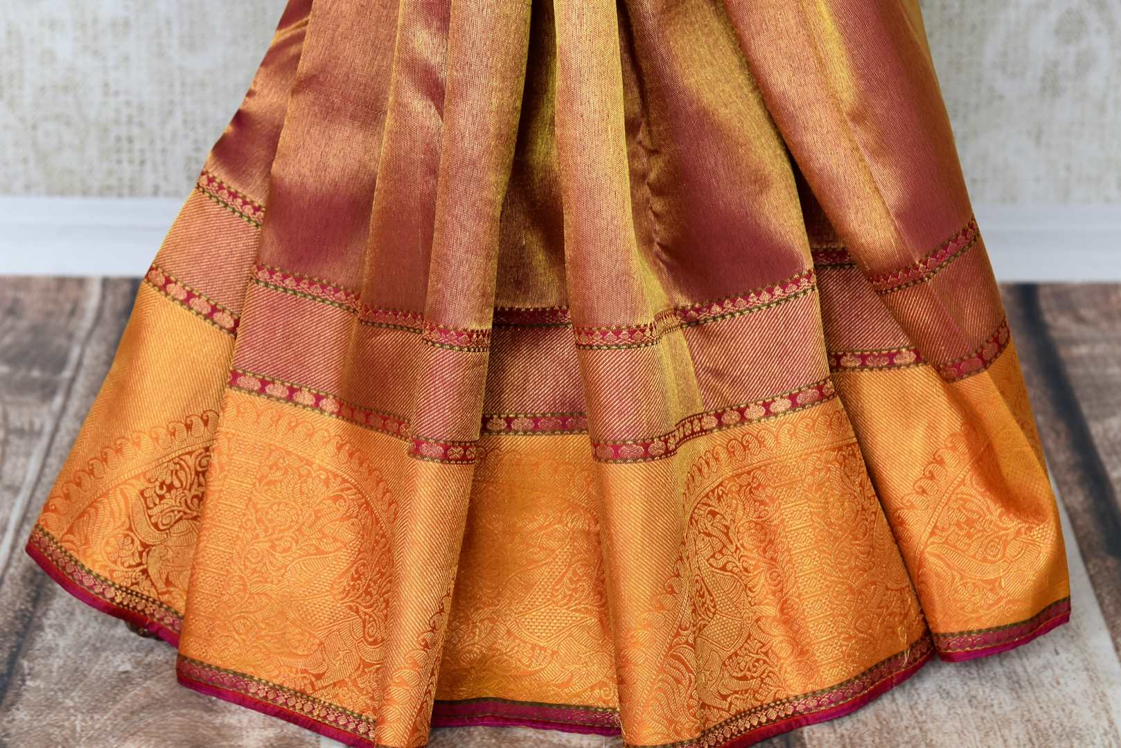 Don this gorgeous handwoven pure kanjeevaram silk sari with zari weave on the border complemented by a stunning contrasted blouse to weddings and festivities. Celebrate the season of weddings and shop handloom sarees, designer silk saris, ikkat sarees, banarsi silk sarees online or visit Pure Elegance store in USA. -pleats