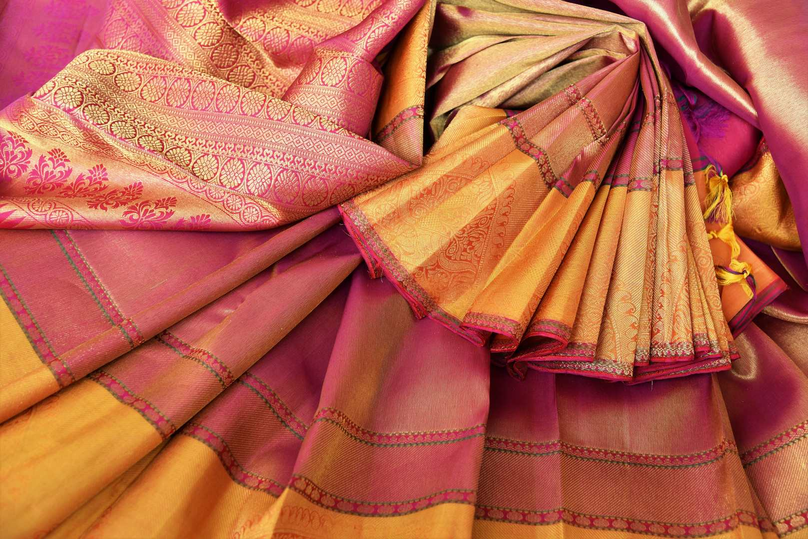Don this gorgeous handwoven pure kanjeevaram silk sari with zari weave on the border complemented by a stunning contrasted blouse to weddings and festivities. Celebrate the season of weddings and shop handloom sarees, designer silk saris, ikkat sarees, banarsi silk sarees online or visit Pure Elegance store in USA. -details