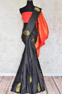 Sashay in this designer black kanjeevaram silk sari with beautiful gold buta work and rich red zari pallu. Pair this Indian designer silk sari with a contrasting red blouse and strut at royal weddings and festivities. Shop handloom saris, banarsi silk sarees, ikkat saris online or visit Pure Elegance store in USA. -full view