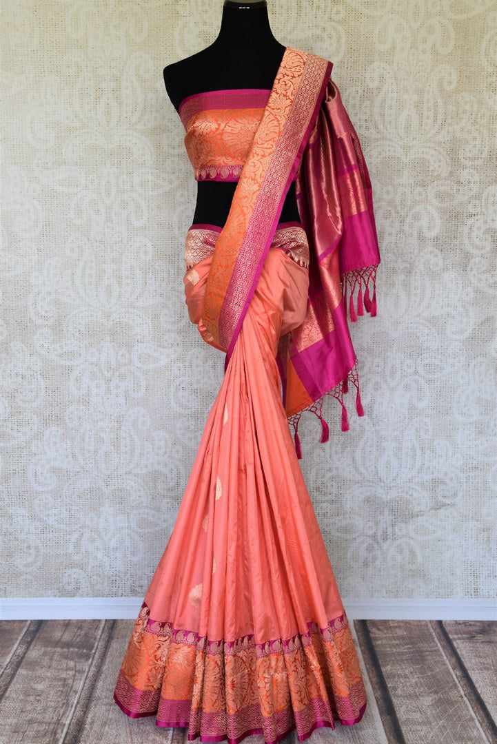 Adorn the flavour of South Indian beauty with our meticulously crafted pink banarsi silk sari. The stunning combination of pink and orange will leave you mesmerized. Style it with a designer matching blouse. Shop designer silk sari, kanjeevaram silk saree, ikkat sari online or visit Pure Elegance store in the USA. -full view