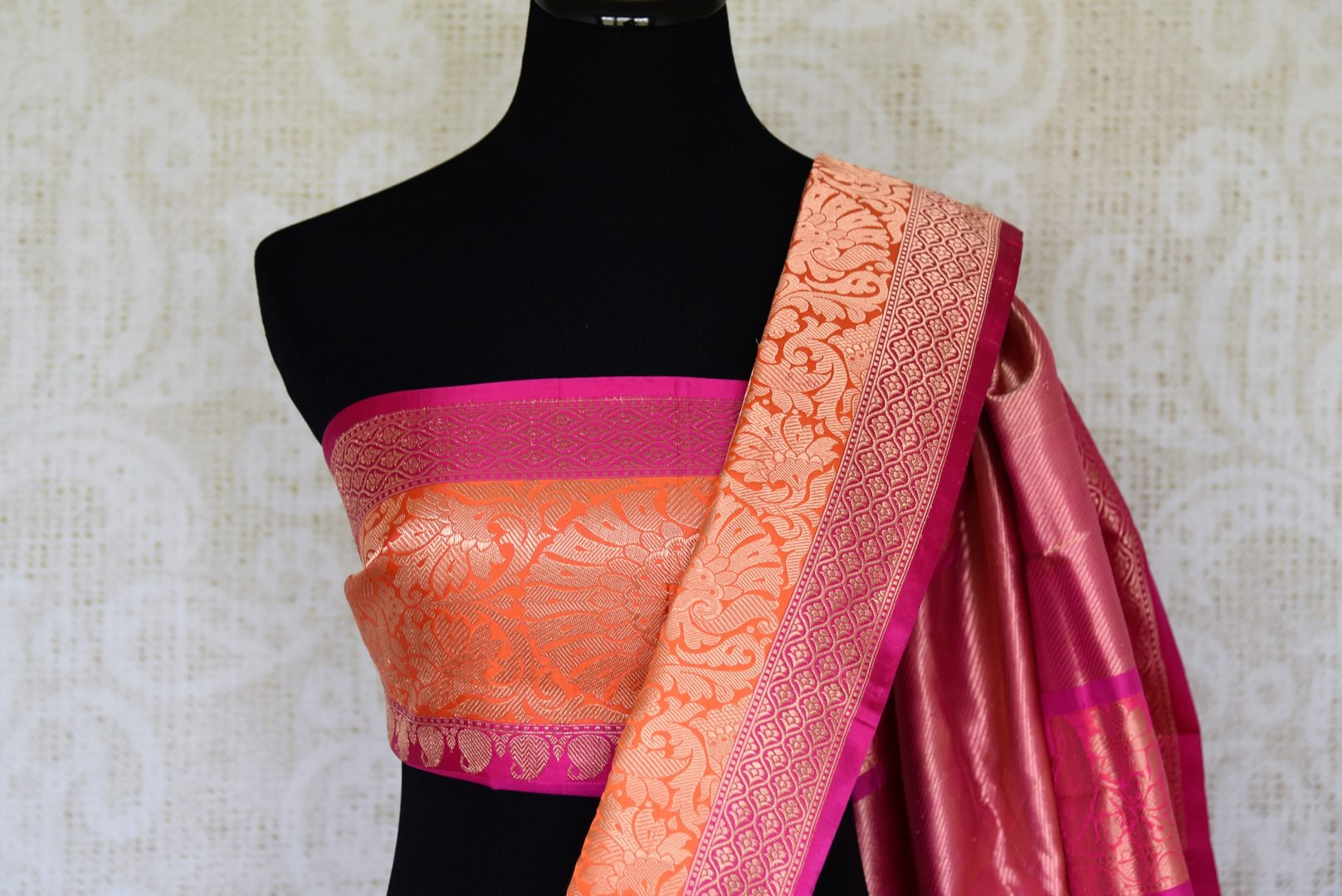 Adorn the flavour of South Indian beauty with our meticulously crafted pink banarsi silk sari. The stunning combination of pink and orange will leave you mesmerized. Style it with a designer matching blouse. Shop designer silk sari, kanjeevaram silk saree, ikkat sari online or visit Pure Elegance store in the USA. -blouse pallu