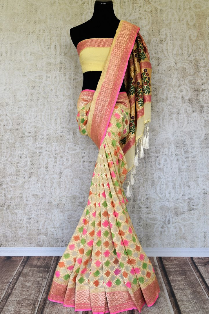 Embrace elegance in this yellow georgette banarsi silk sari. It comes with a handwoven design on the sari with beautiful zari work on border. The pallu features rich heavily floral work embroidered with precision. Shop such handcrafted silk sarees, linen sari, chiffon saree online or visit Pure Elegance store, USA. -full view