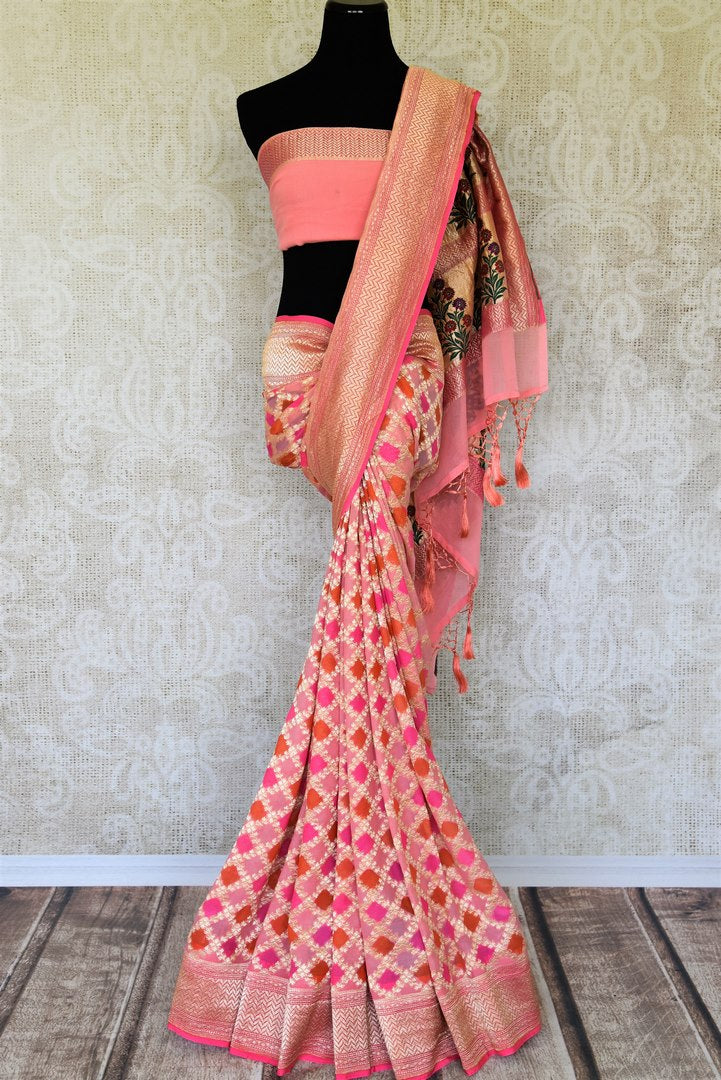 Exude feminity in this pink georgette banarsi silk saree. Perfect for summer-time weddings and parties, this sari comes with a stylish pink blouse. The sari has a zari border and handwoven motifs all over with a rich embroidered pallu. Shop such handcrafted silk sarees online or visit Pure Elegance store, USA. -full view