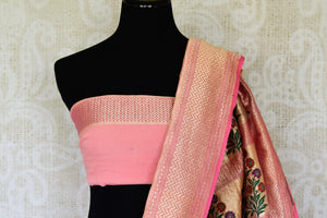 Exude feminity in this pink georgette banarsi silk saree. Perfect for summer-time weddings and parties, this sari comes with a stylish pink blouse. The sari has a zari border and handwoven motifs all over with a rich embroidered pallu. Shop such handcrafted silk sarees online or visit Pure Elegance store, USA. -blouse pallu
