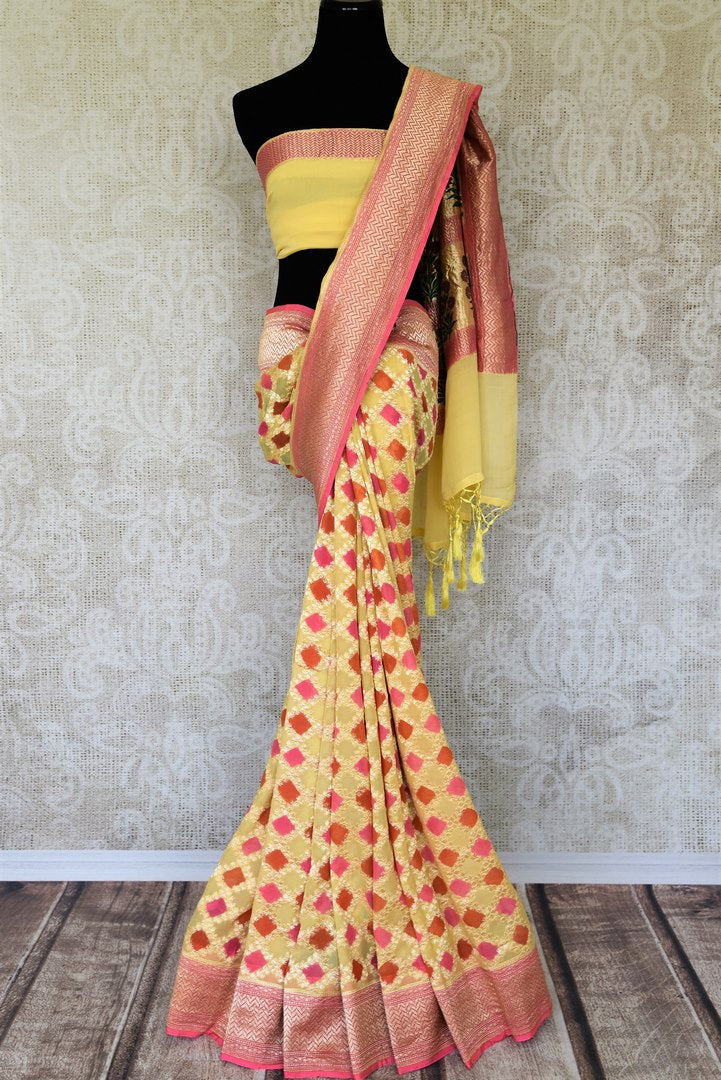 Look alluring in this gorgeous yellow georgette banarsi silk saree. It comes with a royal zari border and handwoven motifs all over the sari. Style it with a yellow zari detailed blouse. Shop printed sarees, embroidery sari online or visit Pure Elegance store, USA.-full view