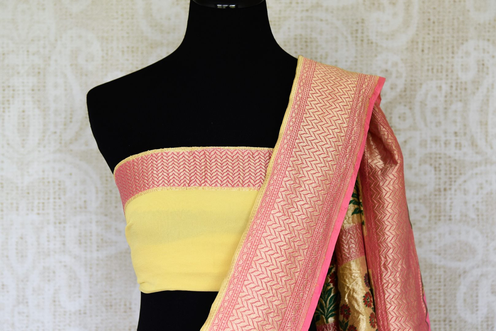 Look alluring in this gorgeous yellow georgette banarsi silk saree. It comes with a royal zari border and handwoven motifs all over the sari. Style it with a yellow zari detailed blouse. Shop printed sarees, embroidery sari online or visit Pure Elegance store, USA.-blouse pallu