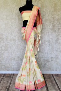 Strike a lasting impression in our white georgette banarasi silk saree. It has a gorgeous zari border accompanied with an equally stunning white zari blouse. Style it for social events, soirees and family gatherings. Shop such designer printed sari, embroidery saree online or visit Pure Elegance store, USA.-full view