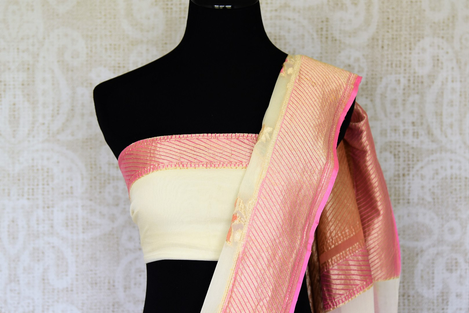 Strike a lasting impression in our white georgette banarasi silk saree. It has a gorgeous zari border accompanied with an equally stunning white zari blouse. Style it for social events, soirees and family gatherings. Shop such designer printed sari, embroidery saree online or visit Pure Elegance store, USA.-blouse pallu