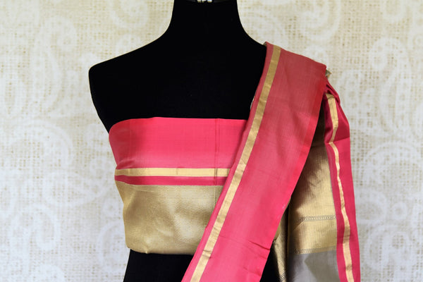 Personify finesse in this charming grey banarsi silk saree with a bright red border. The gorgeous sari features handwoven zari all over with visually appealing gold pallu to enhance its sheer beauty. It comes with a contrasting blouse. Shop designer saris, handloom sarees online or visit Pure Elegance store, USA. -blouse pallu