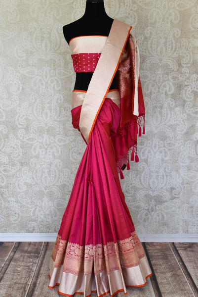 Channel traditional ladylike vibes in this pink banarsi silk saree with fine zari border. The signature bridal trousseau sari comes with a red and zari blouse with buta work. Shop such designer silk saris, banarsi silk saree, kanjeevaram silk sari online or visit Pure Elegance store, USA.-full view
