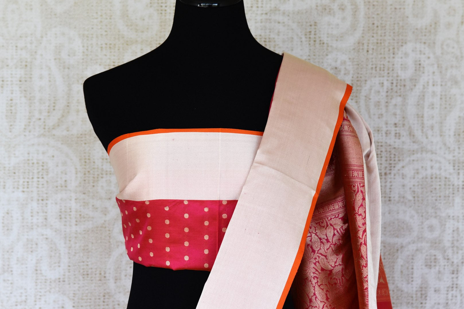 Channel traditional ladylike vibes in this pink banarsi silk saree with fine zari border. The signature bridal trousseau sari comes with a red and zari blouse with buta work. Shop such designer silk saris, banarsi silk saree, kanjeevaram silk sari online or visit Pure Elegance store, USA.-blouse pallu