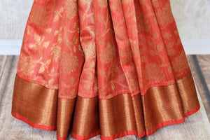 Adorn this flamboyant pink tussar banarsi silk saree with elongate zari detailing all over. It comes with a designer zari blouse and zari border to accentuate the finery of this ensemble. Shop designer silk sari, tussar sarees, handloom sari online or visit Pure Elegance store, USA.-pleats