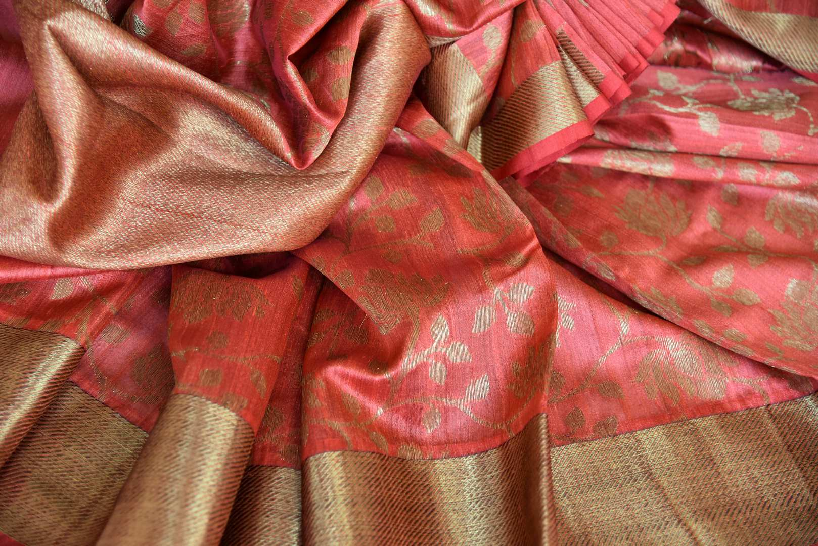 Adorn this flamboyant pink tussar banarsi silk saree with elongate zari detailing all over. It comes with a designer zari blouse and zari border to accentuate the finery of this ensemble. Shop designer silk sari, tussar sarees, handloom sari online or visit Pure Elegance store, USA.-details