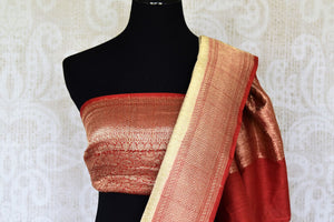 Treat yourself with this suave white khaddi banarsi silk saree paired with a stunning designer red blouse. Featuring zari work on the saree, and intricate buta work, it looks spectacular. Shop such designer silk sarees, printed sari, embroidery saree online or visit Pure Elegance store, USA.-blouse pallu