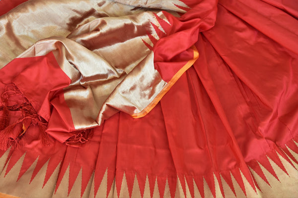 The classic red and gold banarsi silk saree never goes out of vogue. Such is the charm of this elegant handwoven saree. Style it with a deep red and zari detailed blouse to steal the spotlight. Shop such designer saris, silk sarees, banarsi silk sari, ikkat sarees online or visit Pure Elegance store, USA-details