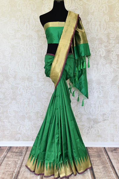 Indulge in this authentic south silk Green banarasi silk saree with a stunning gold border. Exquisitely designed, this flamboyant sari features delicate gold zari detailing on the border. The heavily woven pallu enhances elegance of this sari. Shop designer sari, silk saree, online or visit Pure Elegance store, USA. -full view