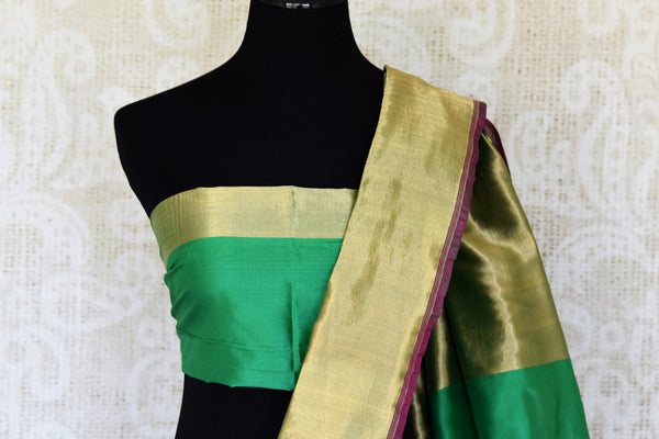 Indulge in this authentic south silk Green banarasi silk saree with a stunning gold border. Exquisitely designed, this flamboyant sari features delicate gold zari detailing on the border. The heavily woven pallu enhances elegance of this sari. Shop designer sari, silk saree, online or visit Pure Elegance store, USA. -blouse pallu