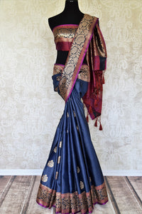 Swing in the gorgeous traditional royal blue tussar banarsi silk sari. It comes with a designer zari border and a contrasting pink designer blouse to steal the show. The buta work all over the sari exudes flamboyance of a kind. Shop designer silk sari, printed saree online or visit Pure Elegance store, USA.-full view