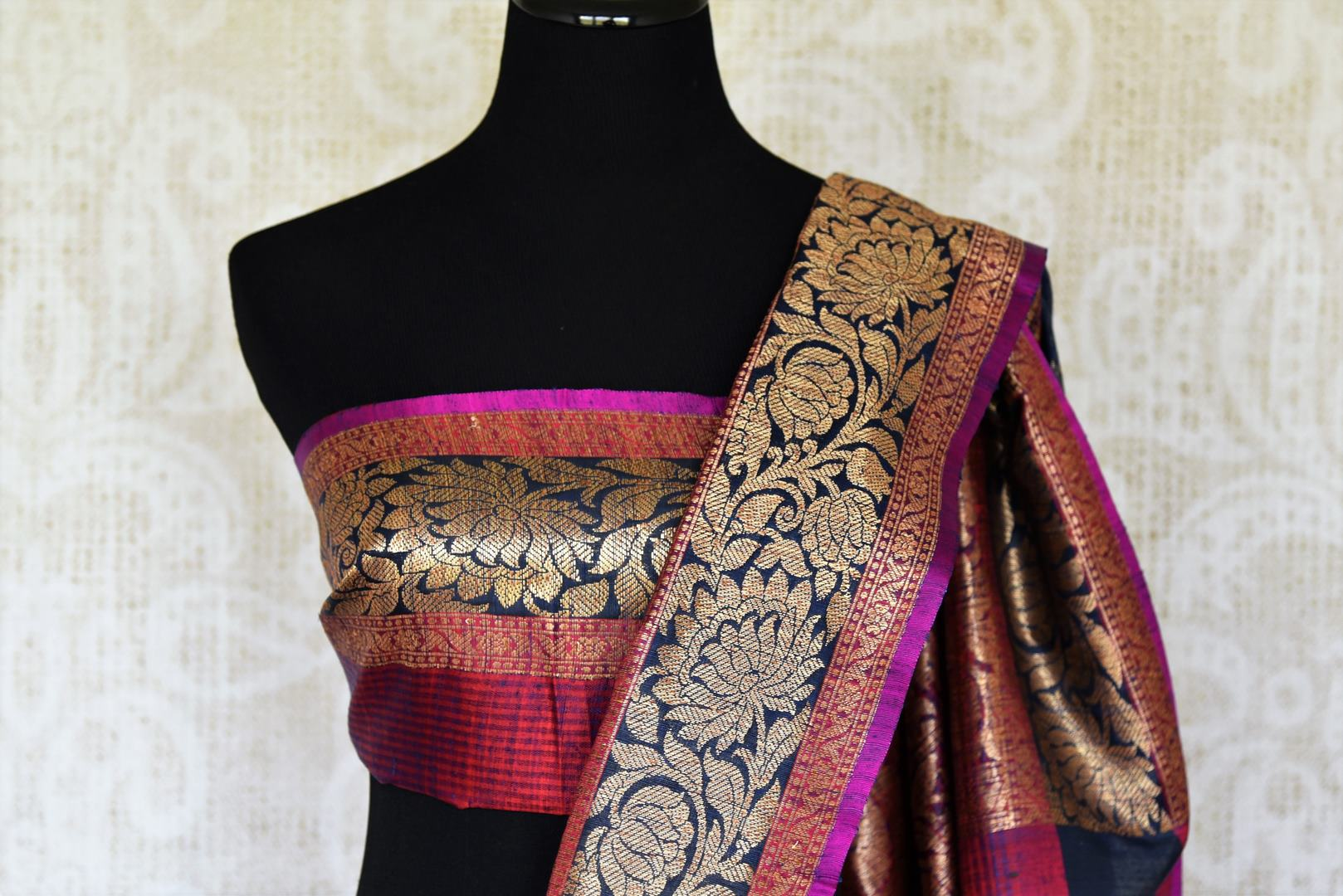 Swing in the gorgeous traditional royal blue tussar banarsi silk sari. It comes with a designer zari border and a contrasting pink designer blouse to steal the show. The buta work all over the sari exudes flamboyance of a kind. Shop designer silk sari, printed saree online or visit Pure Elegance store, USA.-blouse pallu